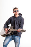Image of teenager in black clothes, hoodie and sunglasses who is Stock Photos