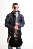 Image of teenager in black clothes, hoodie and sunglasses who is Royalty Free Stock Photos