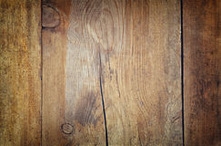 Image of textured wooden board with grain and scratches. image is retro style filtered with faded effect Stock Photo