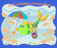 The image on the theme of autumn, funny fish under umbrella