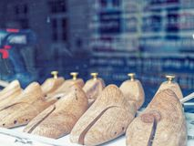 Wooden shoe pads are in the shop window. Manufacture and repair of footwear. Royalty Free Stock Image