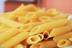 Italian pasta, pennette rigate. In this image there is an assortment of pasta named `Pennette Rigate`, namely Italian cereals. Pasta is a very popular product stock photo