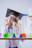 Image of thoughtful little girl in chemistry lab Stock Photo