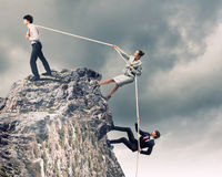 Three business people pulling rope Royalty Free Stock Photos