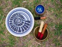 Tibetan bowls and Tibetan bells. Sacred tools for high energy. Image of tibetan bowls. Tools for energy. The sound of singing bowls. Yoga time Royalty Free Stock Image