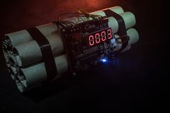 Image of a time bomb against dark background. Timer counting down to detonation illuminated in a shaft light shining through the d. Arkness, conceptual image Royalty Free Stock Photo