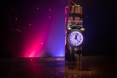 Image of a time bomb against dark background. Timer counting down to detonation illuminated in a shaft light shining through the. Darkness, conceptual image royalty free stock photos