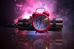 Image of a time bomb against dark background. Timer counting down to detonation illuminated in a shaft light shining through the. Darkness, conceptual image stock images