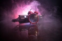 Image of a time bomb against dark background. Timer counting down to detonation illuminated in a shaft light shining through the. Darkness, conceptual image stock image