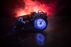 Image of a time bomb against dark background. Timer counting down to detonation illuminated in a shaft light shining through the royalty free stock photography