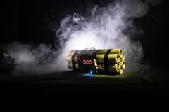 Image of a time bomb against dark background. Timer counting down to detonation illuminated in a shaft light shining through the d. Arkness, conceptual image Stock Photo
