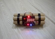 Image of a time bomb on floor. Timer counting down to detonation illuminated in a shaft light shining through the darkness. Conceptual image Royalty Free Stock Photography
