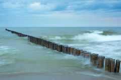 Image with time exposure of waves at breakwaters in the Baltic Sea.  Stock Photos