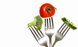 Tomato with fork Royalty Free Stock Photos