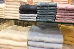 Towels on shelves Stock Photography