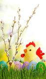 Image of toy chick and Easter eggs in grass closeup Royalty Free Stock Photo