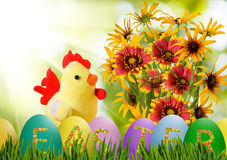 Image of toy chick and Easter eggs in grass closeup Royalty Free Stock Photos