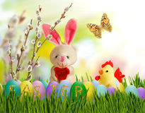 Image of toy hare,chick and Easter eggs in grass Royalty Free Stock Photo