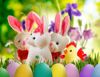 Image of toy hare,chick and Easter eggs in grass close-up Stock Photos