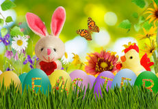 Image of toy hare,chick and Easter eggs in grass close-up Royalty Free Stock Photography
