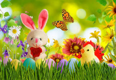 Image of toy hare,chick and Easter eggs in grass closeup Royalty Free Stock Photography