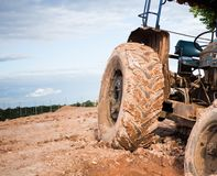 The image of the tractor in the mud Stock Photos