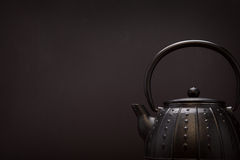 Image of traditional eastern teapot over dark background Royalty Free Stock Photo