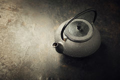 Image of traditional eastern teapot. On rustic background Stock Image