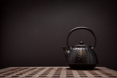 Image of traditional eastern teapot on wooden desk Stock Photos