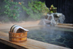 Japanese open air hot spa onsen. Image of traditional open air hot spa in Japan royalty free stock photo