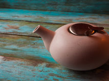 Image of traditional teapot on rustic background Royalty Free Stock Image