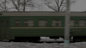 Image of train standing on tracks in winter stock video