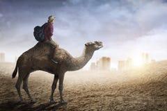 Image of traveler riding camel Stock Photo