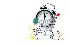 Image of trolley with golden alarm clock, Christmas tree, greeting card, ribbon. On empty white background. Place for text Stock Images
