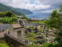 Image of tropical grave yard on island stock image