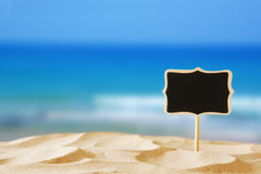 Image of tropical sandy beach and blank chalkboard sign Stock Photos