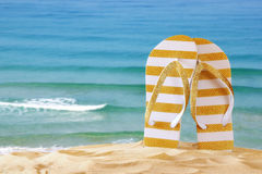 Image of tropical sandy beach and flip flops Stock Photo