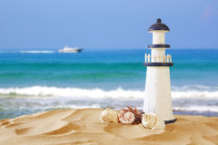 Image of tropical sandy beach, lighthouse and seashells Stock Photography