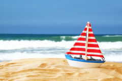 Image of tropical sandy beach and sailboat Stock Photos