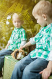Image of twin boys posing with guinea pig Royalty Free Stock Images