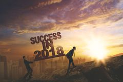 Two businessmen with text of success in 2018 stock photo