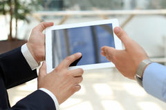 Image of two  businessmen using touchpad Stock Photography