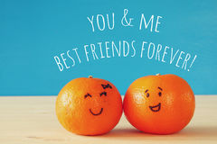 Image of two clementines with drawn smiley faces Stock Photo