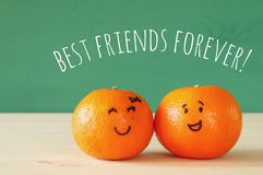 Image of two clementines with drawn smiley faces Royalty Free Stock Image
