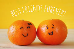 Image of two clementines with drawn smiley faces Stock Photos