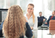 Image of two friendly businesswomen sitting and discussing new i Stock Images