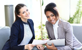 Image of two friendly businesswomen Stock Photos
