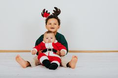 Image of two funny boys wearing christmas outfit. Image of two funny brother boys wearing christmas outfit royalty free stock image