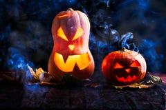Image of two halloween pumpkins on black background. Image of two halloween pumpkins with eyeballs on black background with smoke Stock Image