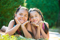 Image of two happy sisters having fun. In the park stock images